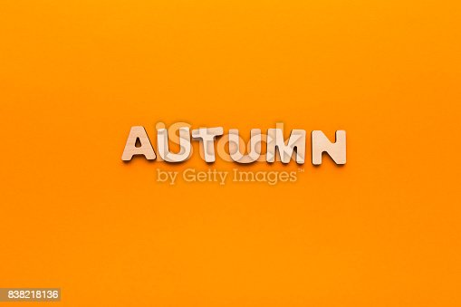 istock Word Autumn on orange background 838218136