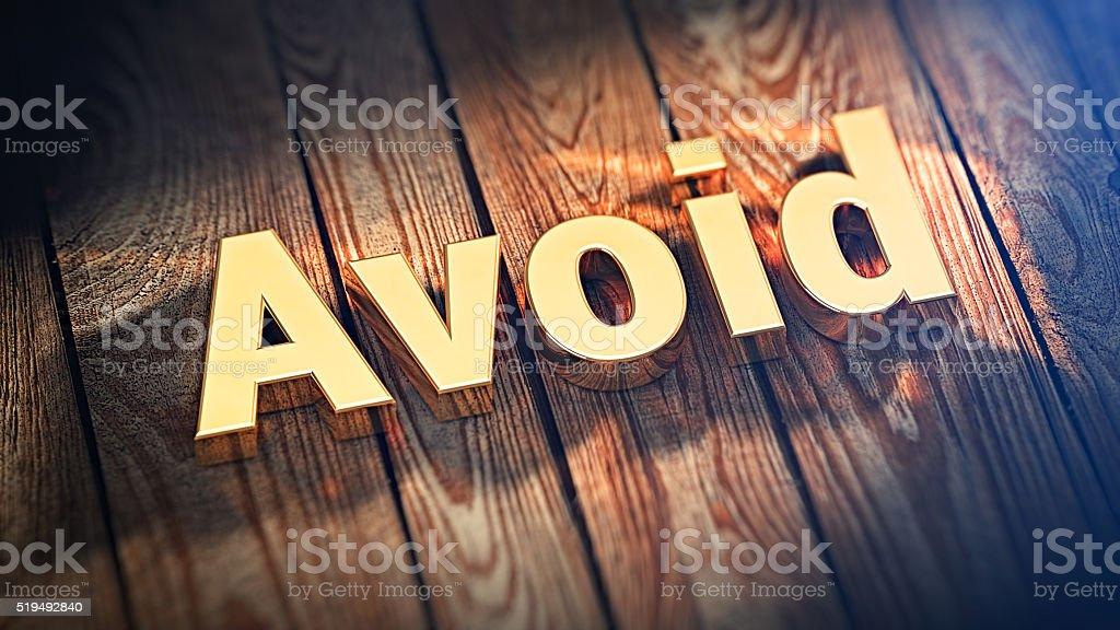 Word Avoid on wood planks stock photo