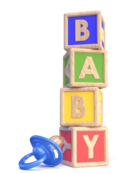 Word BABY made of wooden blocks toy and baby pacifier 3D stock photo
