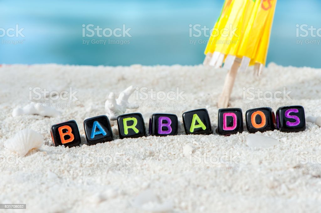 Word Barbados is made of multicolored letters on snow-white sand against the blue sea. Tourism, rest, resort, sea, sun, beach stock photo