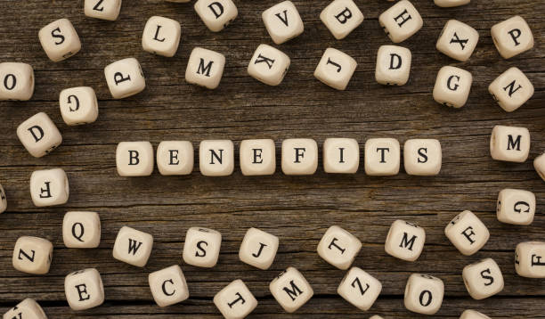 Word BENEFITS written on wood block Word BENEFITS written on wood block,stock image symbiotic relationship stock pictures, royalty-free photos & images
