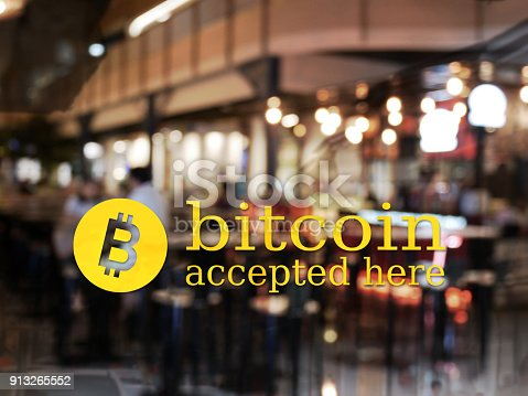 istock word bitcoin accepted here with blur restaurant background. bitcoin electronic money for business concept 913265552