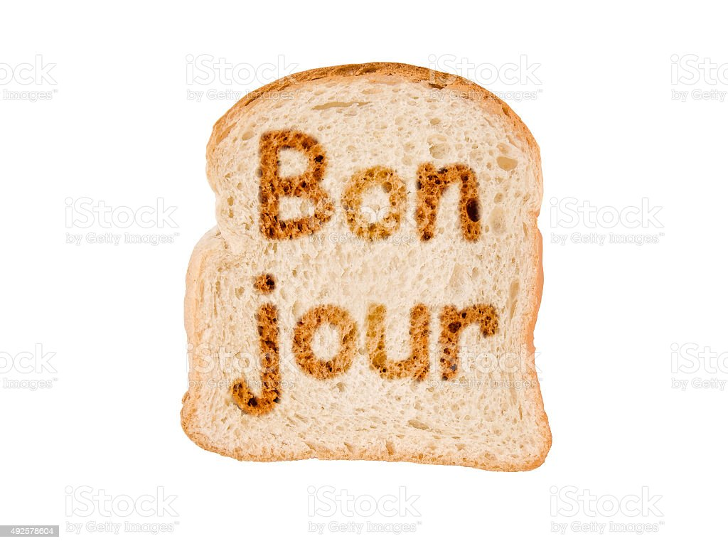 Word bonjour written on a toasted slice of bread stock photo