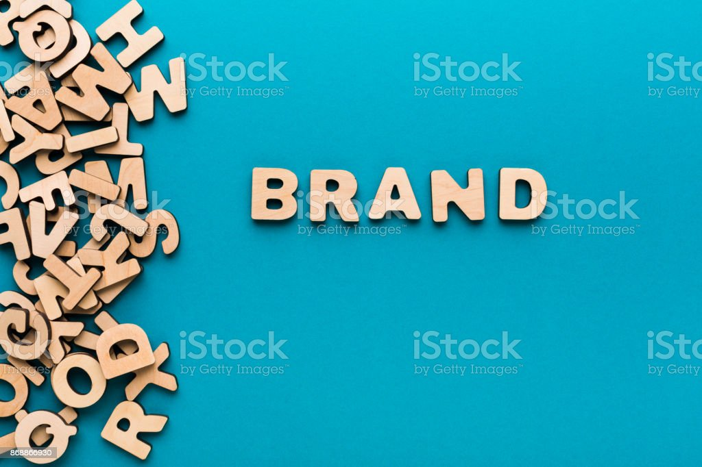 Word Brand on blue background stock photo