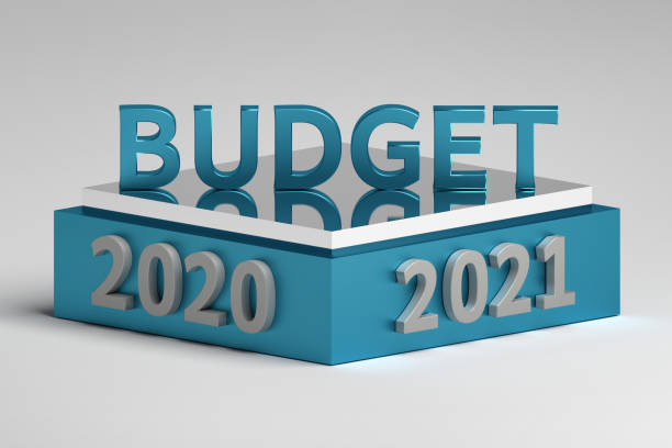 word budget standing on a podium pedestal with 2020 and 2021 year numbers - orçamento imagens e fotografias de stock