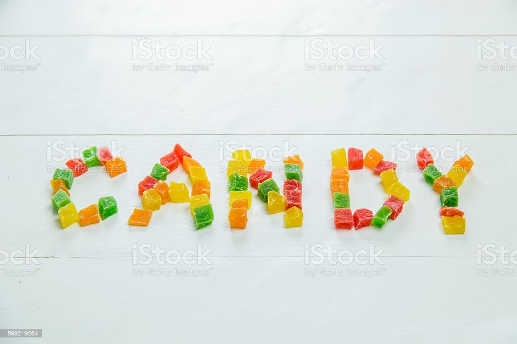 Word candy written with dried pineapples foto royalty-free