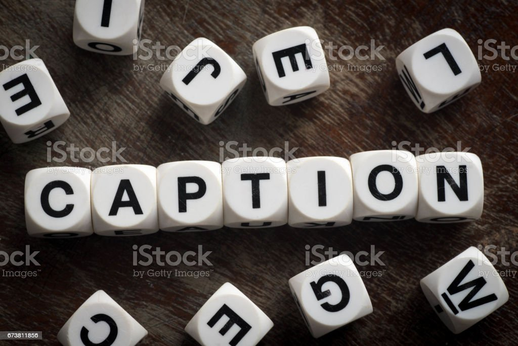 word caption on toy cubes stock photo