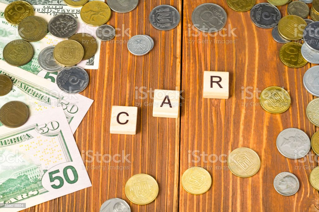 Word CAR on wooden cube with money frame at wood background. Finance concept. stock photo