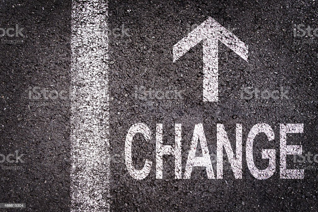 Word change and an arrow written on an asphalt stock photo