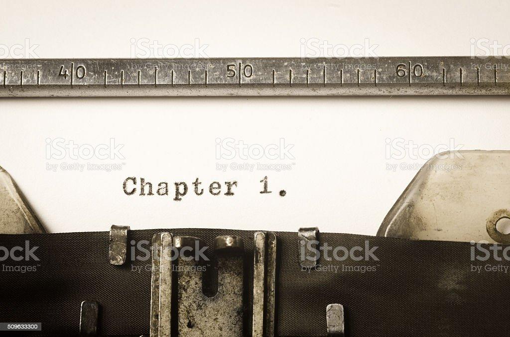 word chapter 1 written on typewriter stock photo