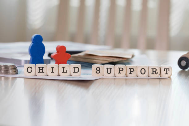 Word CHILD SUPPORT composed of wooden letters. stock photo