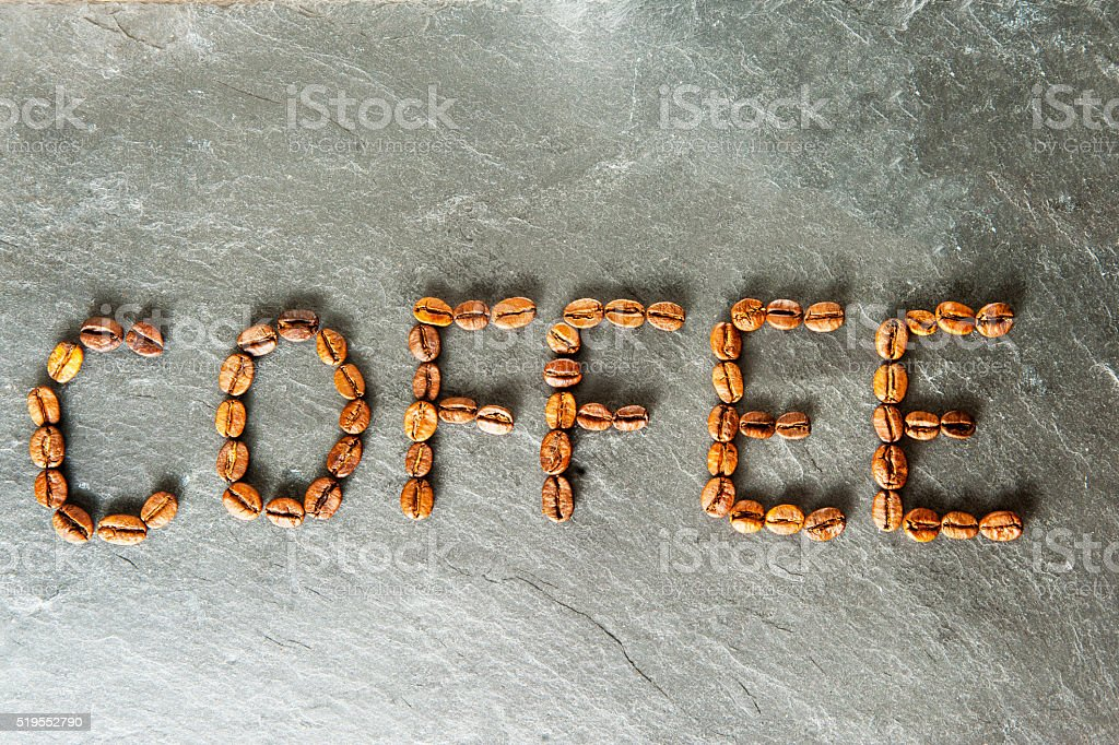 Word COFFEE from coffee beans stock photo