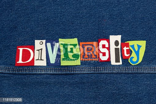 DIVERSITY word collage from cut out tee shirt letters on denim, inclusiveness, horizontal aspect