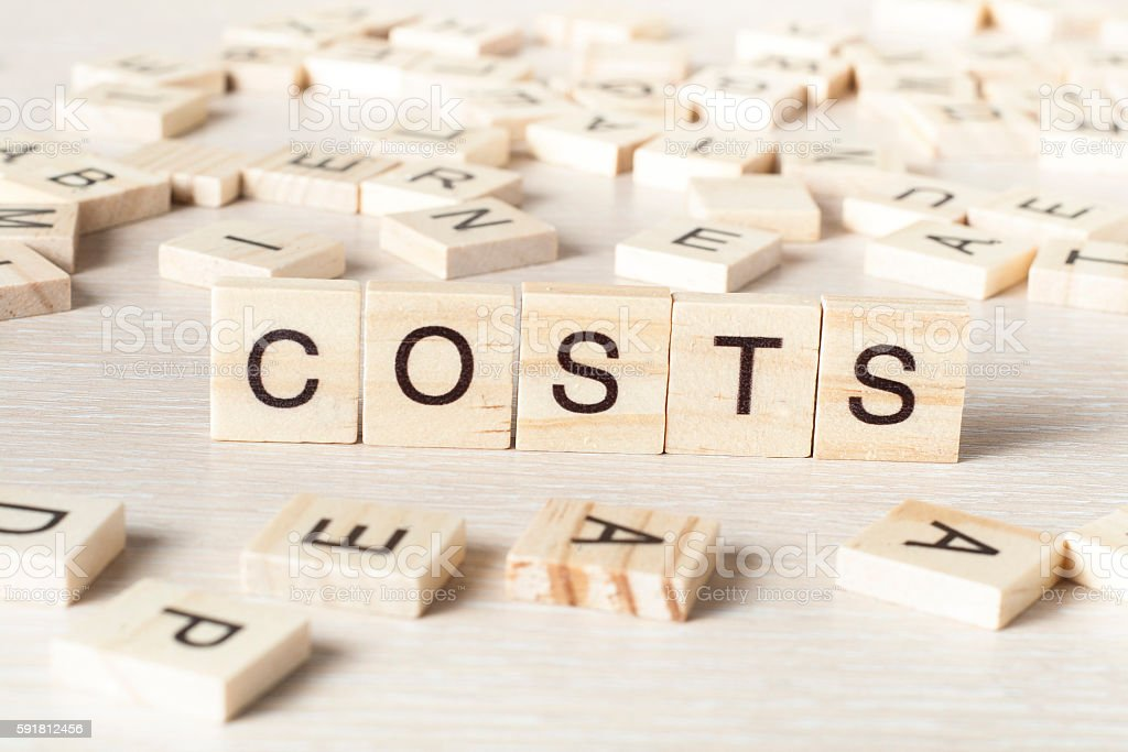 COSTS word concept on wood cubes. Wooden ABC stock photo