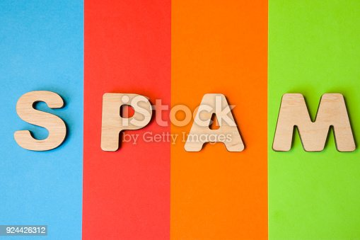 istock Word, concept or abbreviation SPAM photo. Word SPAM composed of 3D letters in background of four colors-blue, red, orange and green. Illustration word for Internet, email, SEO, digital marketing, SERP 924426312