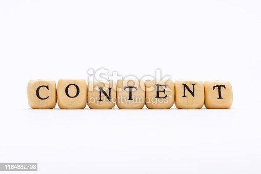 1125093513 istock photo Word content on wooden blocks on white background 1164882706