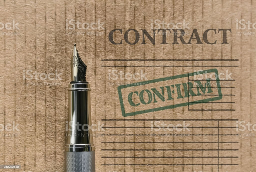 Word Contract and a pen stock photo