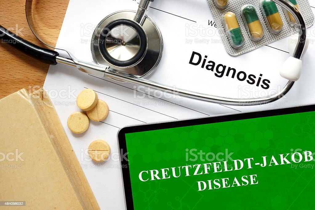 Word Creutzfeldt-Jakob disease on a paper and pills. stock photo