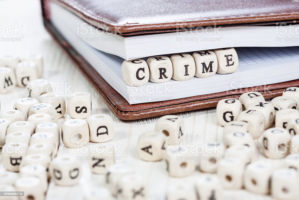 Word CRIME on old wooden table. stock photo