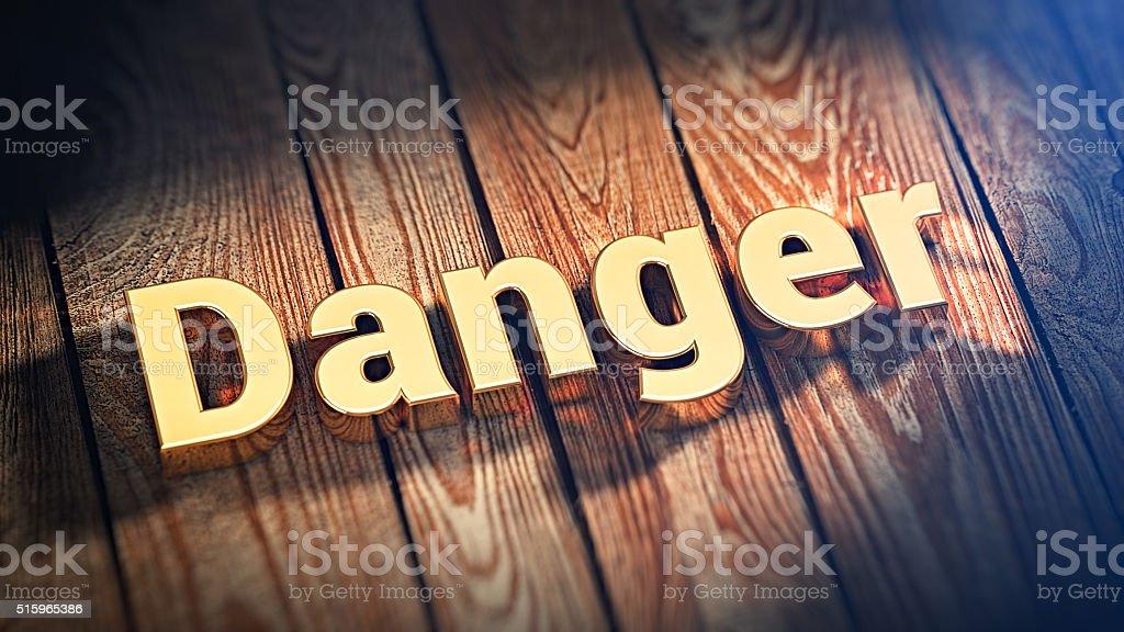 Word Danger on wood planks stock photo