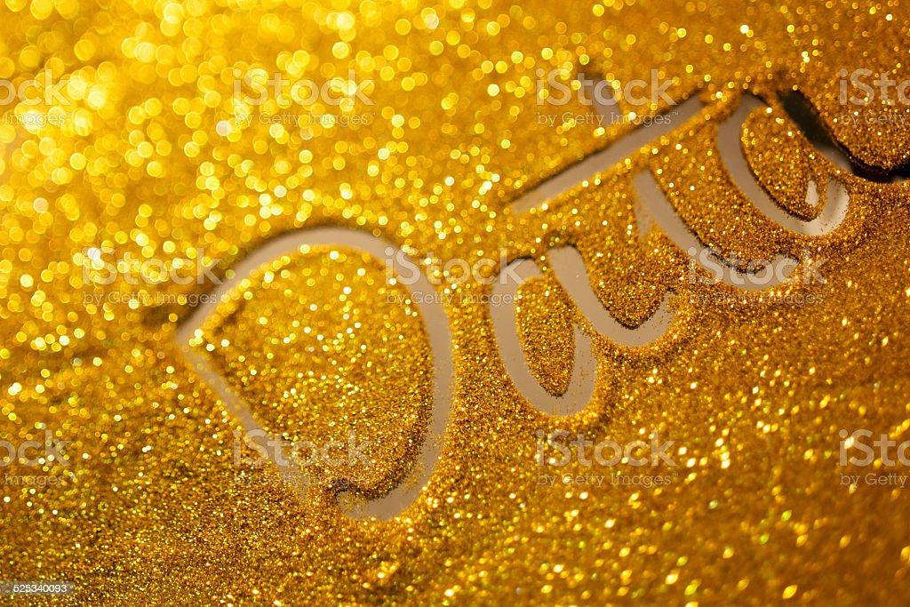 word data writing on golden sand background stock photo