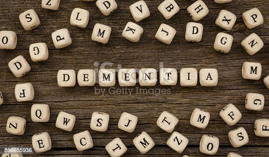 1175869940istockphoto Word DEMENTIA written on wood block 856655936