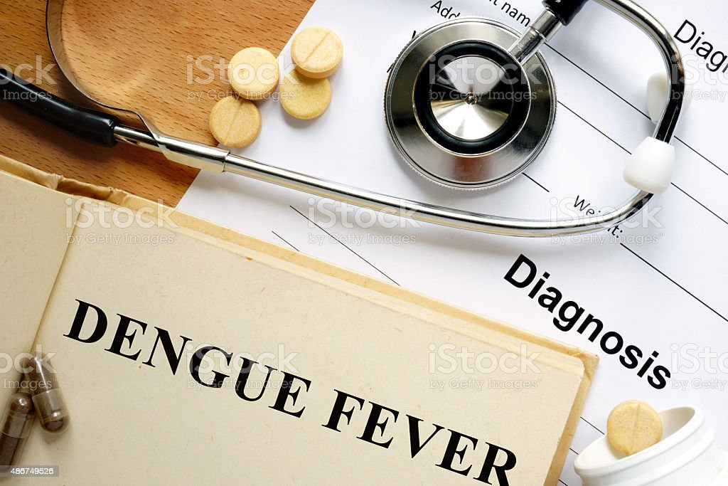 Word Dengue fever on a book and pills. stock photo