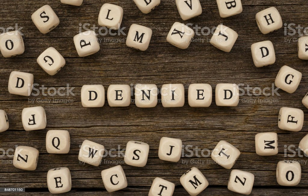 Word DENIED written on wood block stock photo