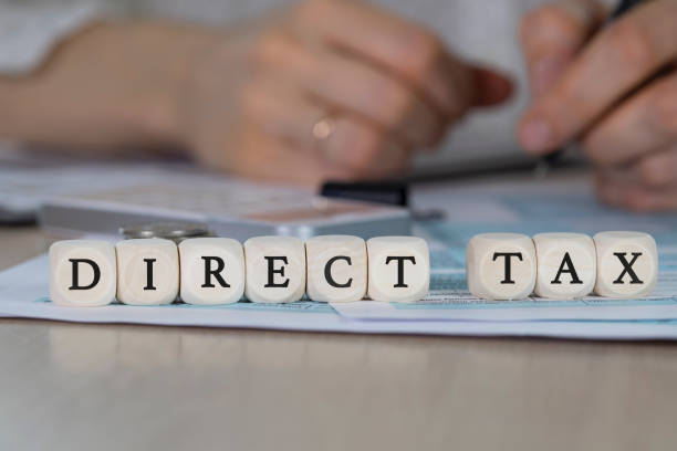 Word DIRECT TAX composed of wooden dices. stock photo