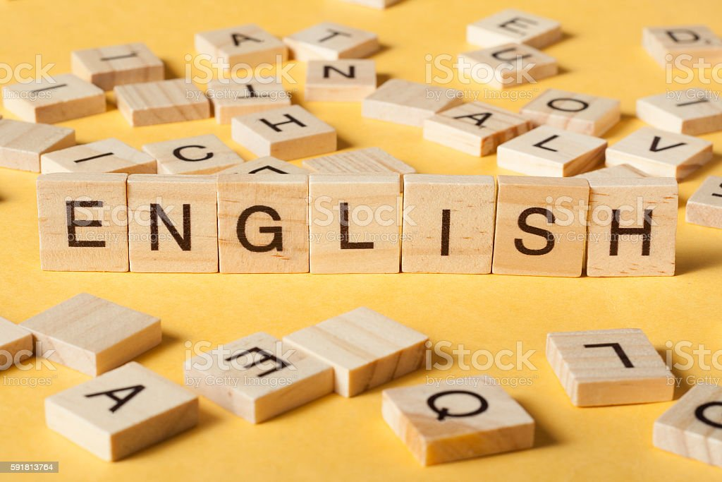 Word english made with block wood letters next to a stock photo