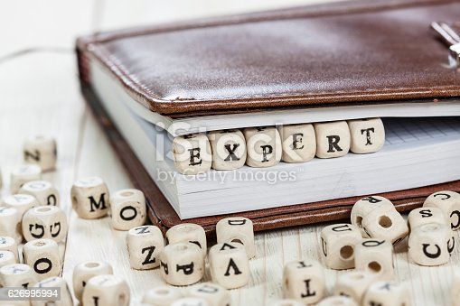 istock Word EXPERT on old wooden table. 626995994
