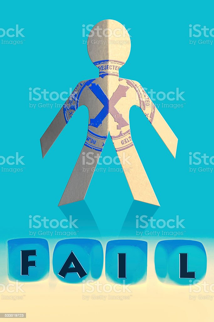 word Fail on cubes in front of paper man stock photo