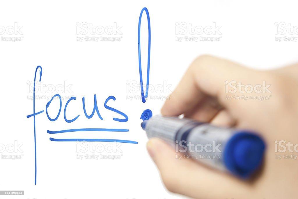 word focus written on whiteboard royalty-free stock photo