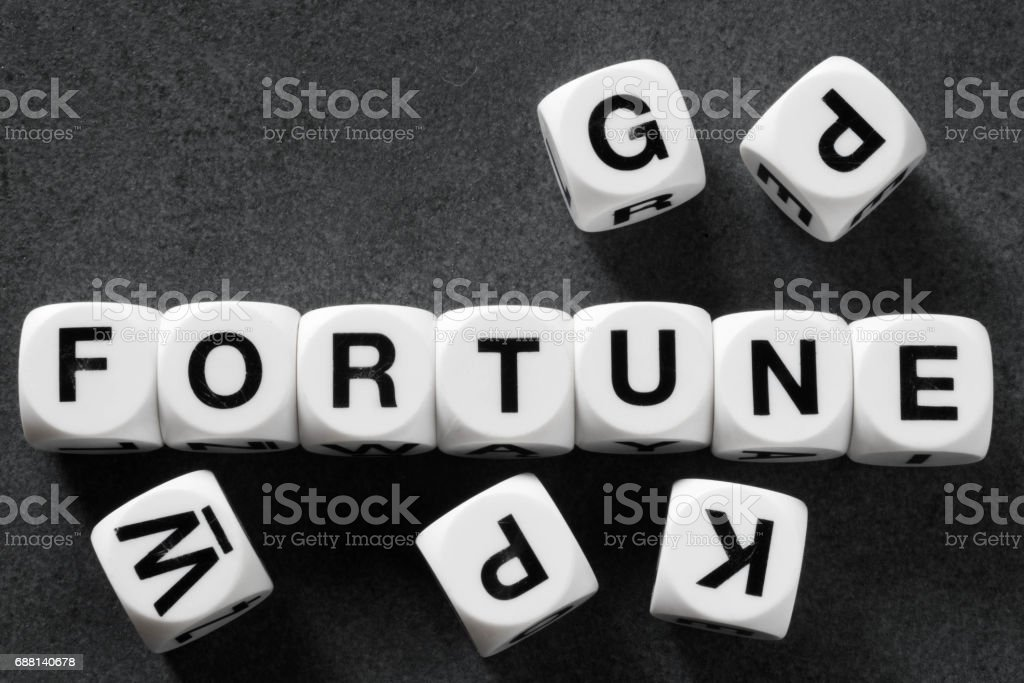 word fortune on toy cubes stock photo