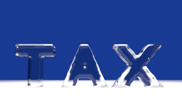TAX word from melting ice letters stock photo