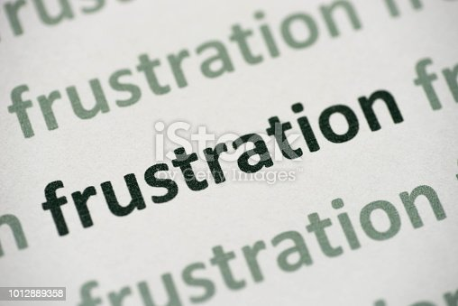 1091817198 istock photo word frustration printed on paper macro 1012889358