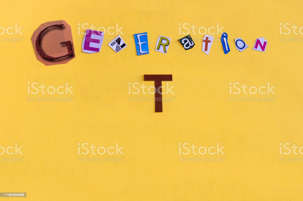 Word 'Generation T' formed with cut letters. The new generation of technology after Millennial also called Alpha Generation or Children of Millennials. stock photo