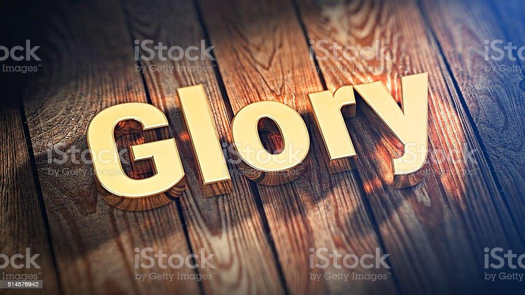 Word Glory on wood planks stock photo
