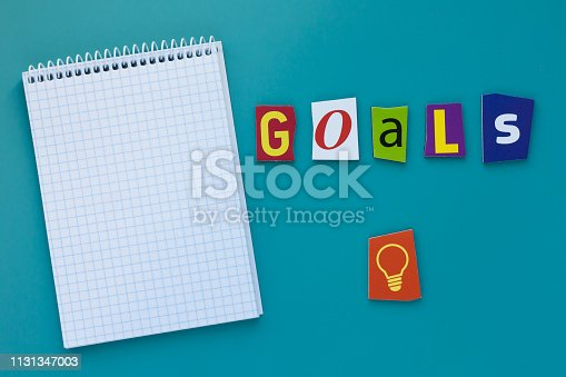istock Word goals. Inscription goals. A word writing text showing concept of goal setting made of different magazine newspaper letter. Word goals on blue background 1131347003