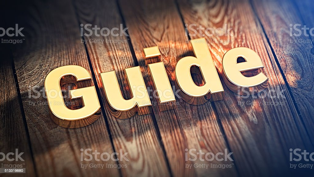 Word Guide on wood planks stock photo