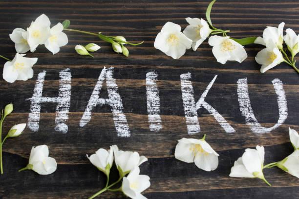 Word Haiku, Japanese Poetry, with Jasmine Flowers stock photo