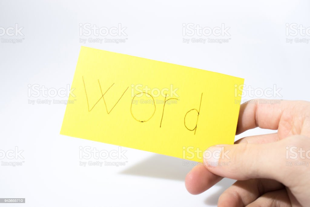 Word handwrite with a hand on a yellow paper composition stock photo