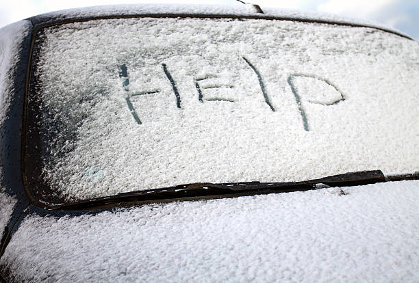 Word Help on the Car Windscreen in Snow stock photo