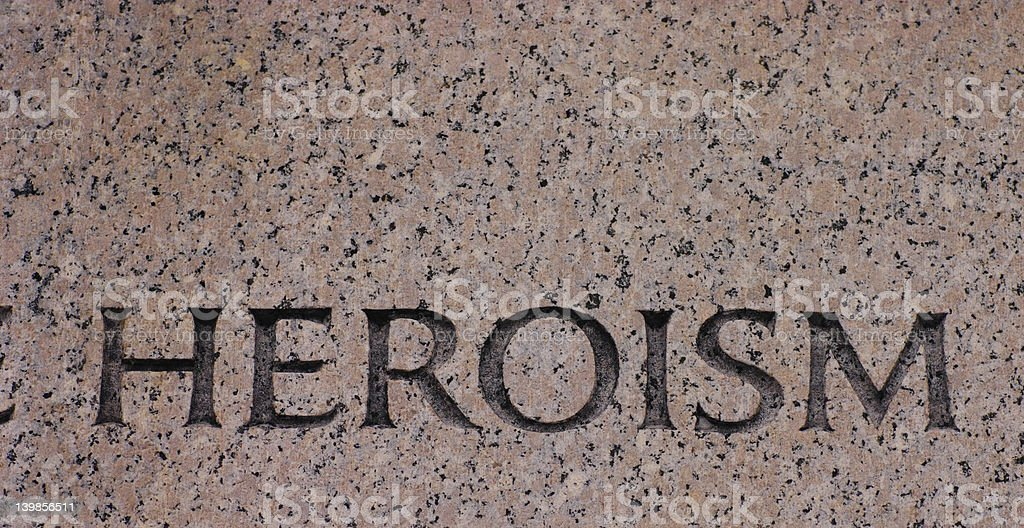 Word Heroism Carved in Gray Granite Hero royalty-free stock photo