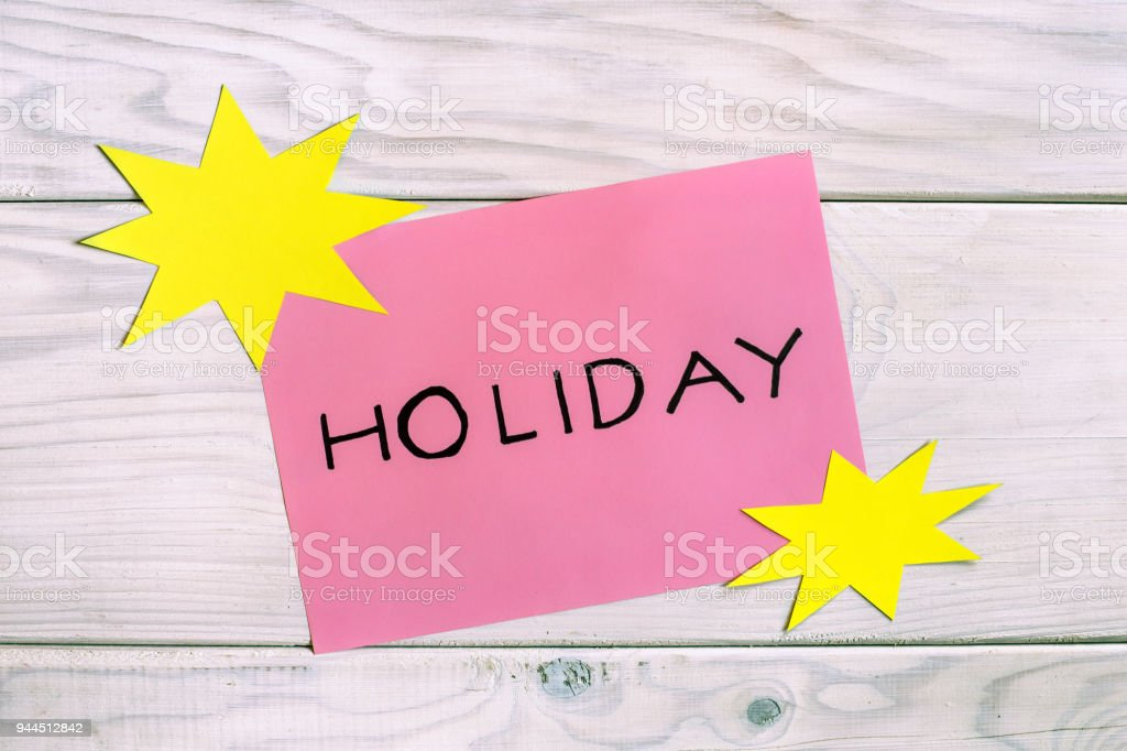 word holiday with sun shapes royalty free stock photo
