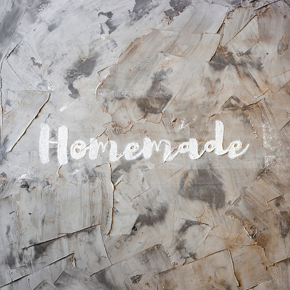 Word Homemade Is Written On A Gray Concrete Background Of Flour Homemade Pastry Concept Top View Flat Lay Stock Photo - Download Image Now