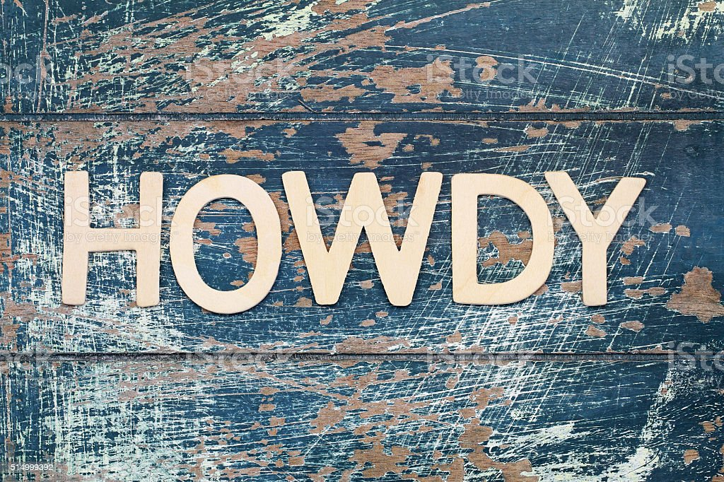 Word howdy written with wooden letters on rustic surface stock photo