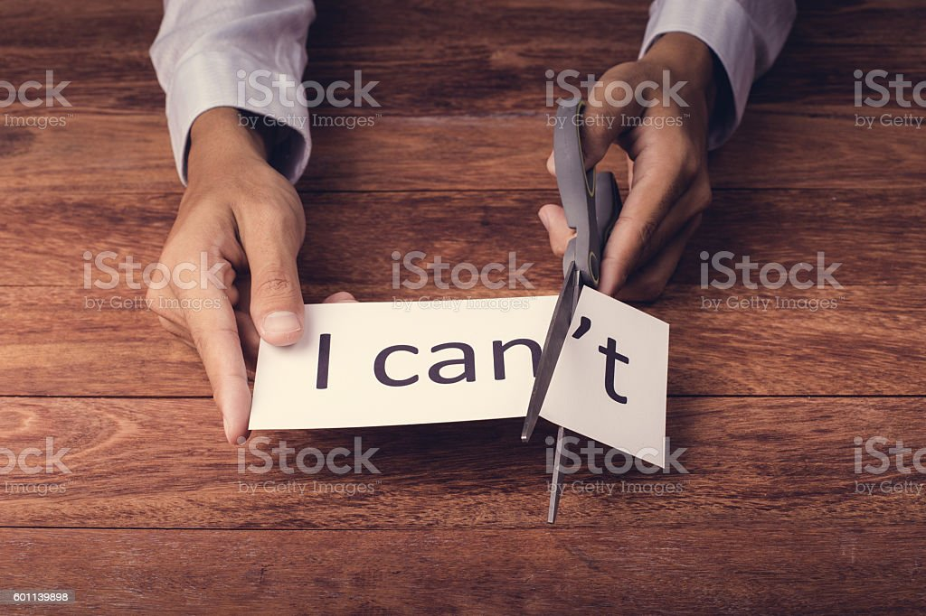word 'I can't' on wooden background stock photo