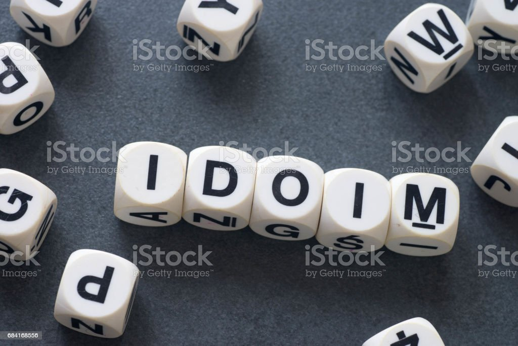 word idiom on toy cubes stock photo