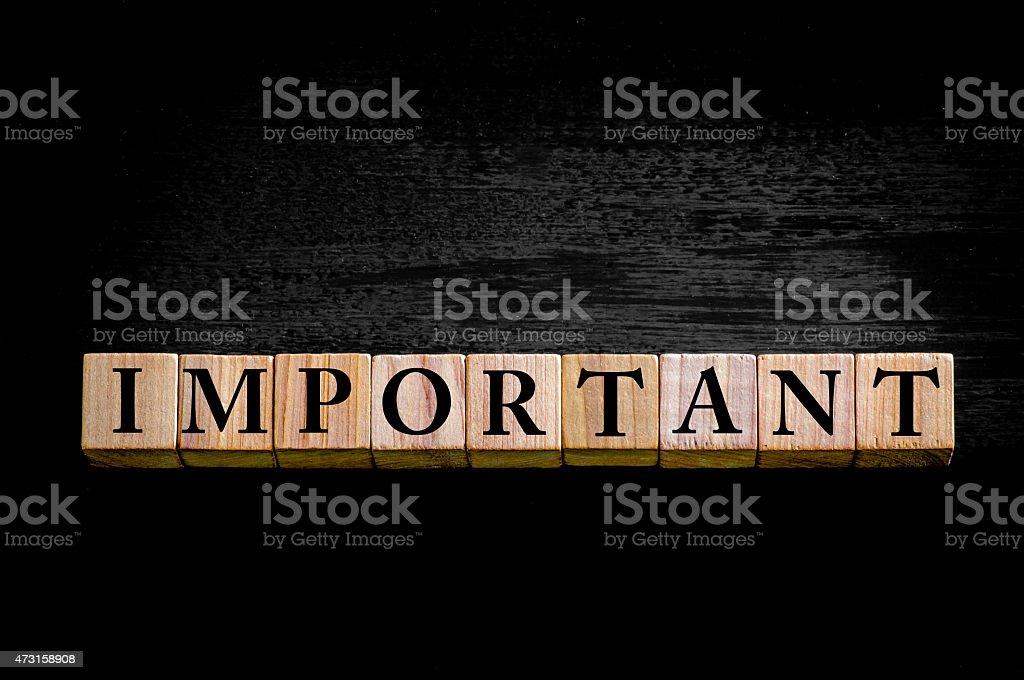 Word IMPORTANT isolated on black background stock photo